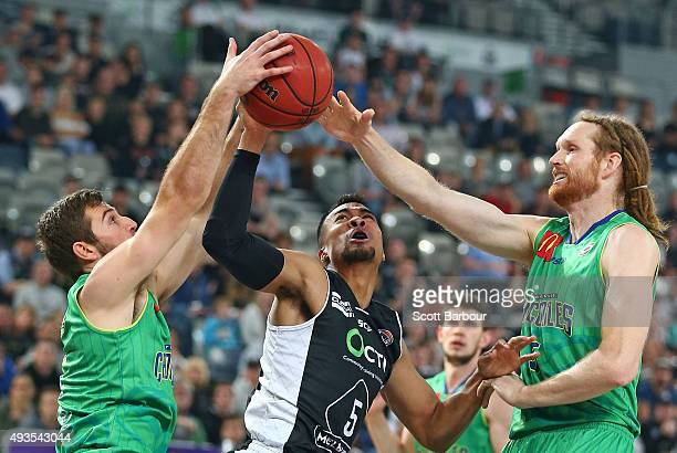 Stephen Holt of Melbourne United and Mitch Norton of the Townsville Crocodiles compete for the ball during the round three NBL match between...
