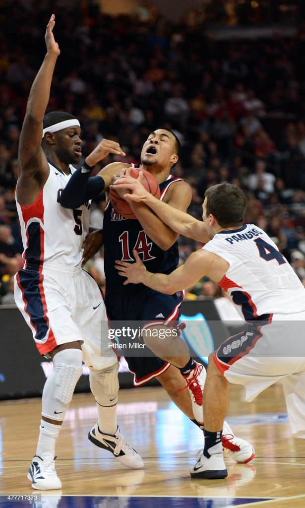 Stephen Holt #14 of the Saint Mary's Gaels drives between Gary Bell Jr. #5 and Kevin Pangos #4 of the Gonzaga Bulldogs during a semifinal game of the West Coast Conference Basketball tournament at the Orleans Arena on March 10, 2014 in Las Vegas, Nevada. Gonzaga won 70-54.