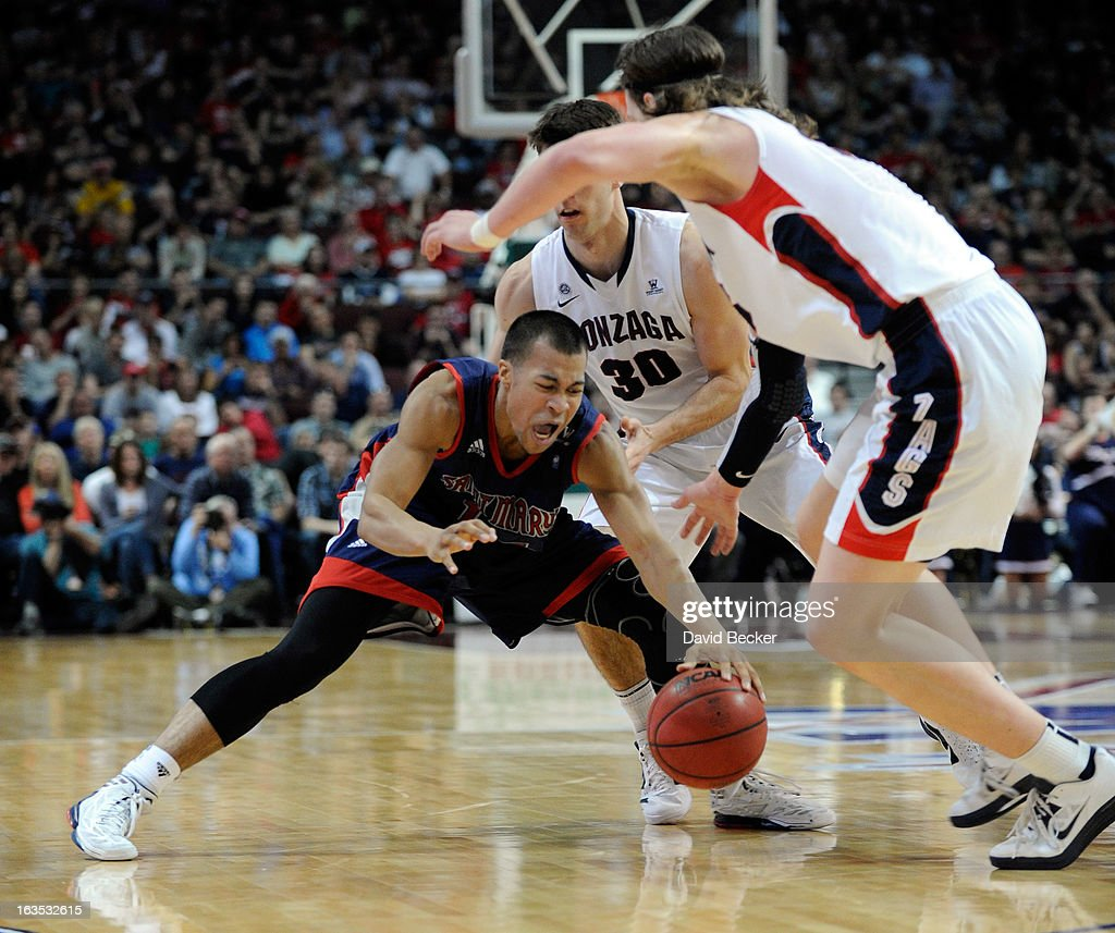 Stephen Holt #14 of the Saint Mary's Gaels is double-teamed by Kelly Olynyk #13 and <a gi-track='captionPersonalityLinkClicked' href=/galleries/search?phrase=Michael+Hart&family=editorial&specificpeople=171689 ng-click='$event.stopPropagation()'>Michael Hart</a> #30 of the Gonzaga Bulldogs during the championship game of the West Coast Conference Basketball tournament at the Orleans Arena March 11, 2013 in Las Vegas, Nevada. Gonzaga won 65-51.