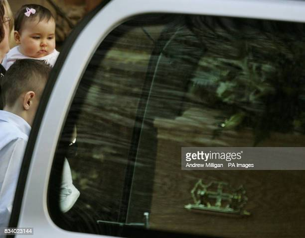 Stephen Humphrey's baby Nina is carried past his coffin after the funeral of tugboat captain at Finnart St Paul's Church Greenock