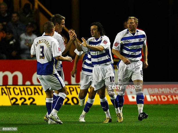Stephen Hunt and Kevin Doyle of Reading celebrate scoring during the CocaCola Championship match between Wolverhampton Wanderers and Reading at...