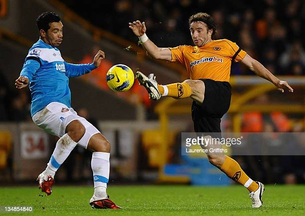 Stephen Hunt of Wolverhampton Wanderers battles with Kieran Richardson of Sunderland during the Barclays Premier League match between Wolverhampton...