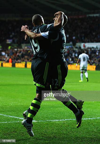 Stephen Ireland of Stoke City celebrates with team mate Jonathan Walters after scoring his sides second goal during the Barclays Premier League match...