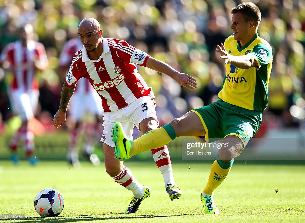 Stephen Ireland of Stoke holds off the challenge of Ryan Bennett of Norwich during the Barclays Premier League match between Stoke City and Norwich City at the Britannia Stadium on September 29, 2013 in Stoke on Trent, England.