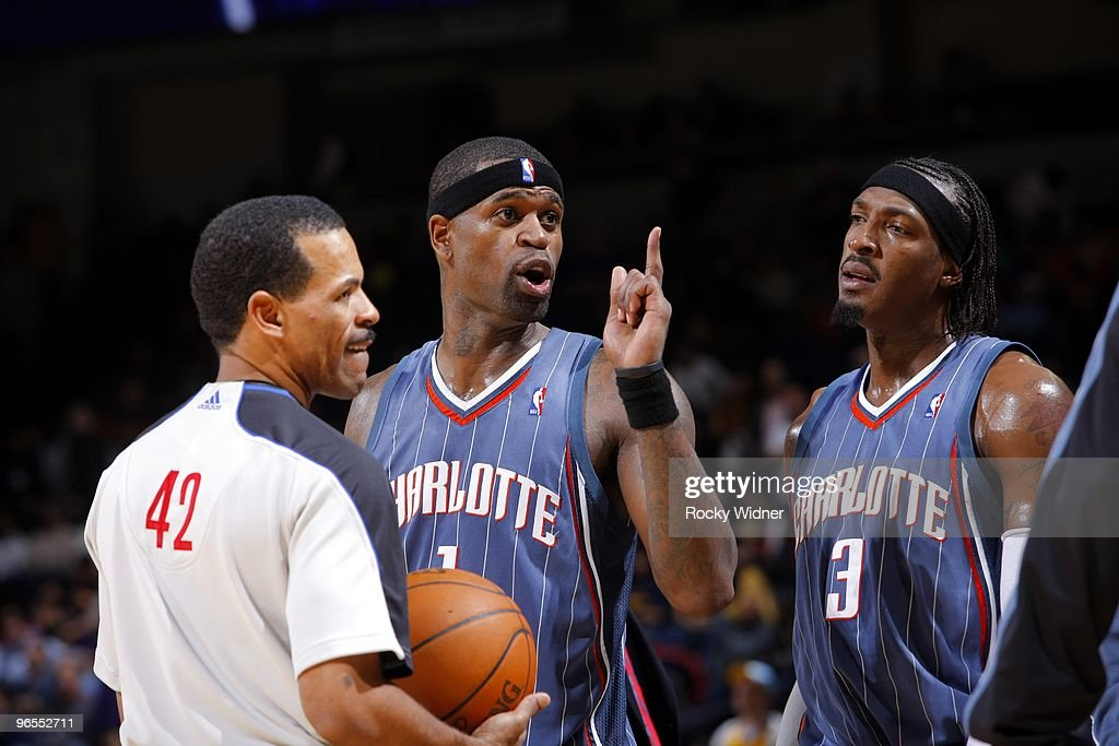 Stephen Jackson and Gerald Wallace of the Charlotte Bobcats talk with referee Eric Lewis during the game against the Golden State Warriors at Oracle...