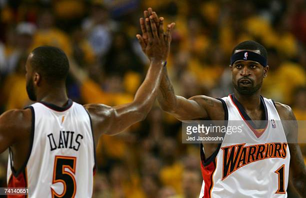 Stephen Jackson highfives Baron Davis of the Golden State Warriors in Game 4 of the Western Conference Semifinals against the Utah Jazz during the...