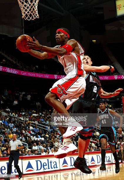 Stephen Jackson of the Atlanta Hawks drives for a shot attempt past Jason Williams of the Memphis Grizzlies during the game at Philips Arena on March...