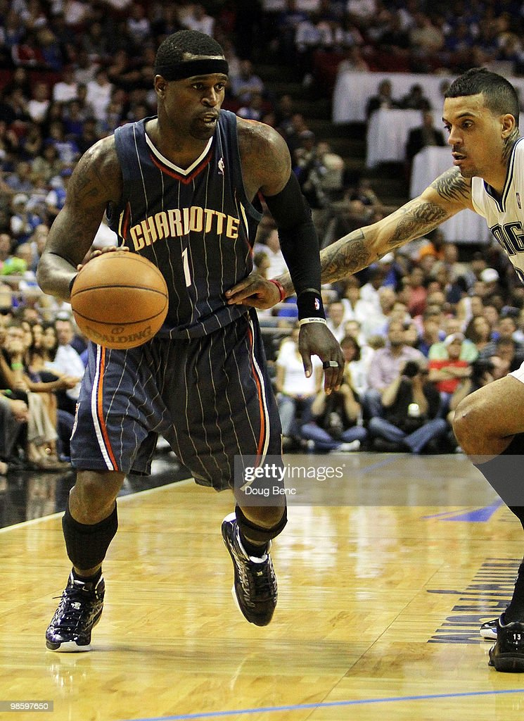 Stephen Jackson of the Charlotte Bobcats drives past Matt Barnes of the Orlando Magic in Game Two of the Eastern Conference Quarterfinals during the...