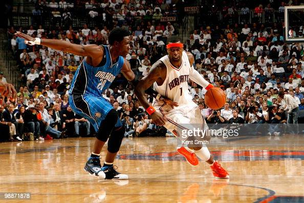 Stephen Jackson of the Charlotte Bobcats drives to the basket past Mickael Pietrus of the Orlando Magic in Game Four of the Eastern Conference...
