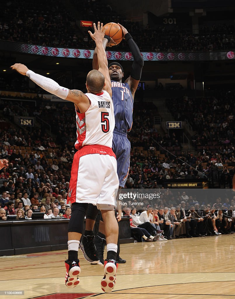 Stephen Jackson #1 of the Charlotte Bobcats shoots against <a gi-track='captionPersonalityLinkClicked' href=/galleries/search?phrase=Jerryd+Bayless&family=editorial&specificpeople=4216027 ng-click='$event.stopPropagation()'>Jerryd Bayless</a> #5 of the Toronto Raptors during the game on March 13, 2011 at the Air Canada Centre in Toronto, Ontario, Canada.