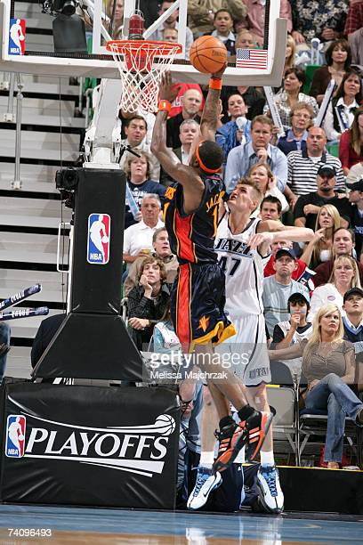 Stephen Jackson of the Golden State Warriors goes for the shot over Andrei Kirilenko of the utah Jazz in Game One of the Western Conference...