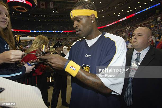 Stephen Jackson of the Indiana Pacers signs autographs before Game one of the Eastern Conference Semifinals against the Detroit Pistons during the...
