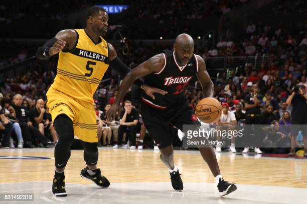 Stephen Jackson of the Killer 3s defends Dion Glover of the Trilogy during week eight of the BIG3 three on three basketball league at Staples Center...