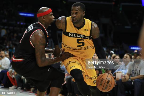 Stephen Jackson of the Killer 3s drives with the ball against Rashad McCants of the Trilogy during week eight of the BIG3 three on three basketball...