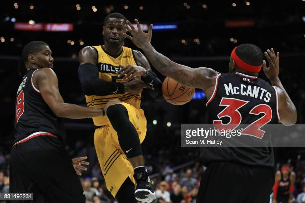 Stephen Jackson of the Killer 3s loses control of the ball to Rashad McCants of the Trilogy during week eight of the BIG3 three on three basketball...