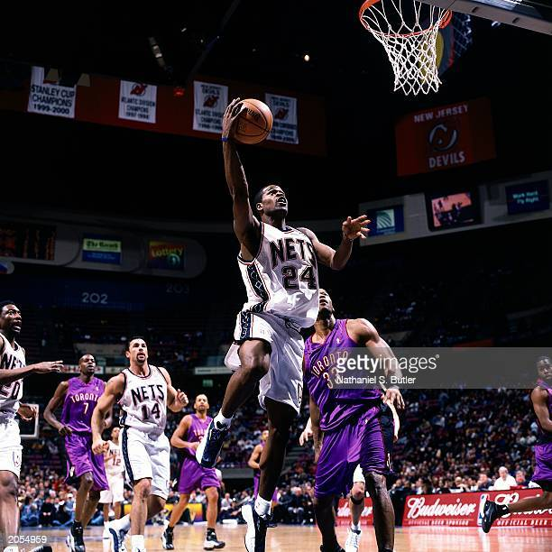 Stephen Jackson of the New Jersey Nets drives to the basket for a layup against the Toronto Raptors during an NBA game at the Continental Airlines...