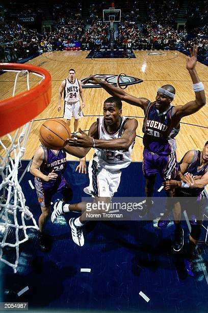 Stephen Jackson of the New Jersey Nets drives to the basket for a layup against the Phoenix Suns during a 2000 season NBA game at the Continental...