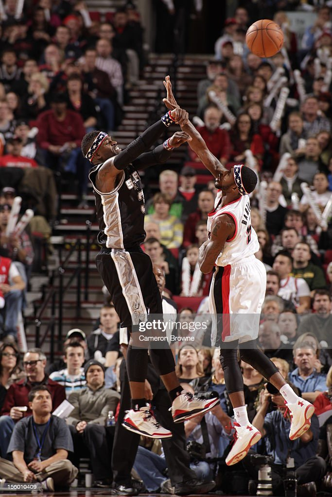 Stephen Jackson #3 of the San Antonio Spurs and Will Barton #5 of the Portland Trail Blazers battle for the ball control during the game between the San Antonio Spurs and the Portland Trail Blazers on November 10, 2012 at the Rose Garden Arena in Portland, Oregon.
