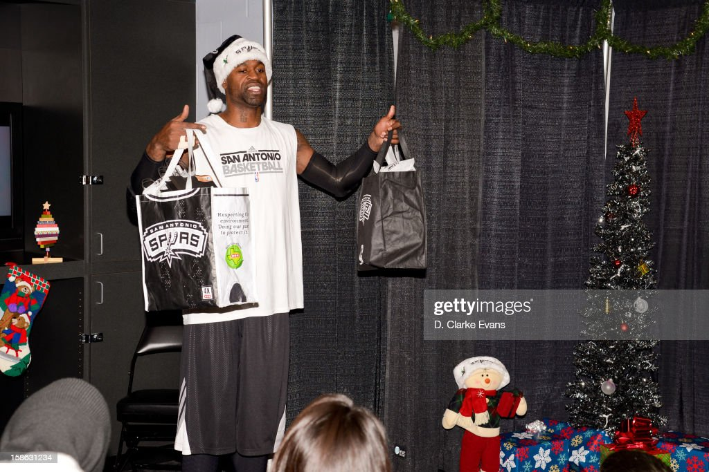 Stephen Jackson #3 of the San Antonio Spurs delivers gift bags to fans before a game against the New Orleans Hornets on December 21, 2012 at the AT&T Center in San Antonio, Texas.