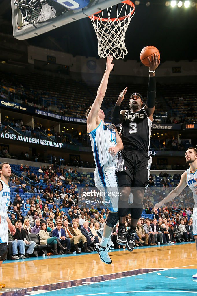 Stephen Jackson #3 of the San Antonio Spurs drives to the basket against Jason Smith #14 of the New Orleans Hornets on January 7, 2013 at the New Orleans Arena in New Orleans, Louisiana.