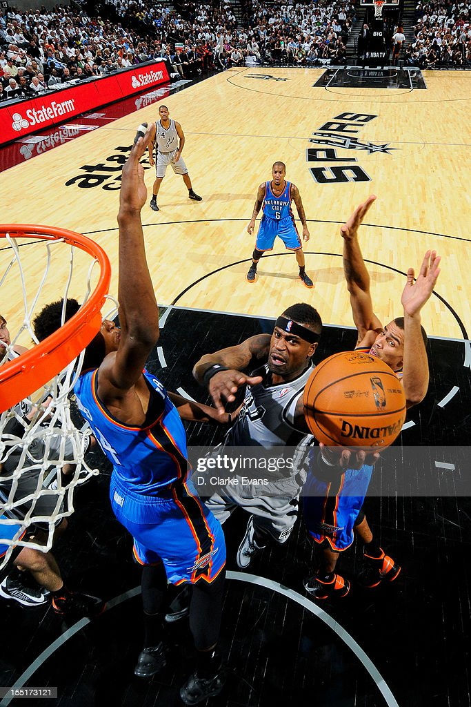 Stephen Jackson #3 of the San Antonio Spurs goes to the basket against <a gi-track='captionPersonalityLinkClicked' href=/galleries/search?phrase=Hasheem+Thabeet&family=editorial&specificpeople=4003778 ng-click='$event.stopPropagation()'>Hasheem Thabeet</a> #34 of the Oklahoma City Thunder on November 1, 2012 at the AT&T Center in San Antonio, Texas.