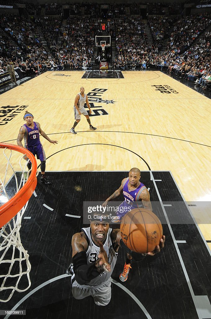 Stephen Jackson #3 of the San Antonio Spurs goes to the basket against <a gi-track='captionPersonalityLinkClicked' href=/galleries/search?phrase=P.J.+Tucker&family=editorial&specificpeople=227316 ng-click='$event.stopPropagation()'>P.J. Tucker</a> #17 of the Phoenix Suns on January 26, 2013 at the AT&T Center in San Antonio, Texas.