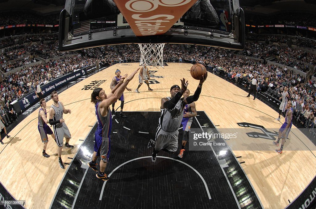 Stephen Jackson #3 of the San Antonio Spurs shoots a layup against <a gi-track='captionPersonalityLinkClicked' href=/galleries/search?phrase=Luis+Scola&family=editorial&specificpeople=2464749 ng-click='$event.stopPropagation()'>Luis Scola</a> #14 of the Phoenix Suns on January 26, 2013 at the AT&T Center in San Antonio, Texas.