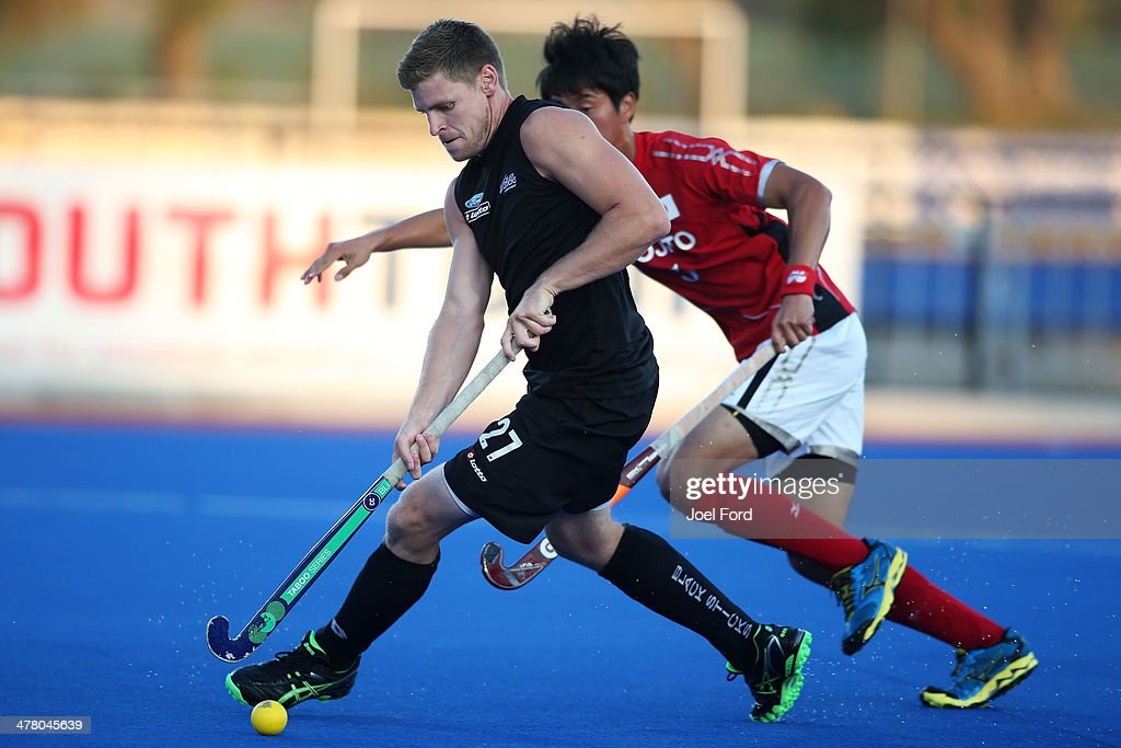 Stephen Jenness of New Zealand runs with the ball during the Test Match between the New Zealand Black Sticks and Japan at Blake Park on March 12, 2014 in Mount Maunganui, New Zealand.