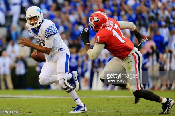 Stephen Johnson of the Kentucky Wildcats scrambles on a pass play during the first half against the Georgia Bulldogs at Sanford Stadium on November...