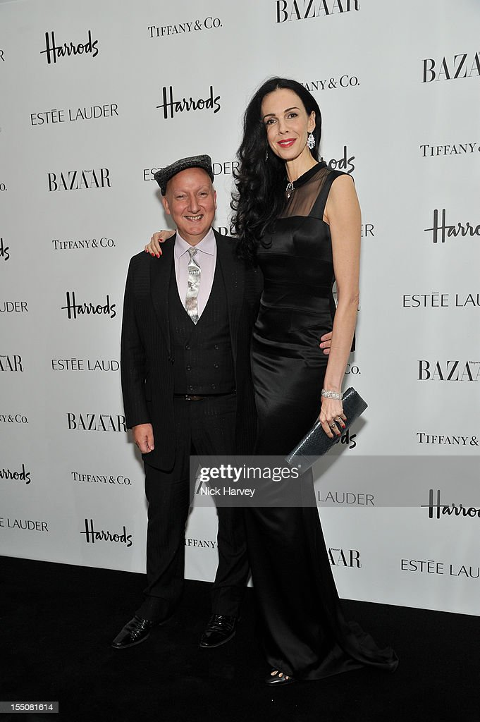 Stephen Jones and L'Wren Scott attend the Harper's Bazaar Woman of the Year Awards at Claridge's Hotel on October 31, 2012 in London, England.
