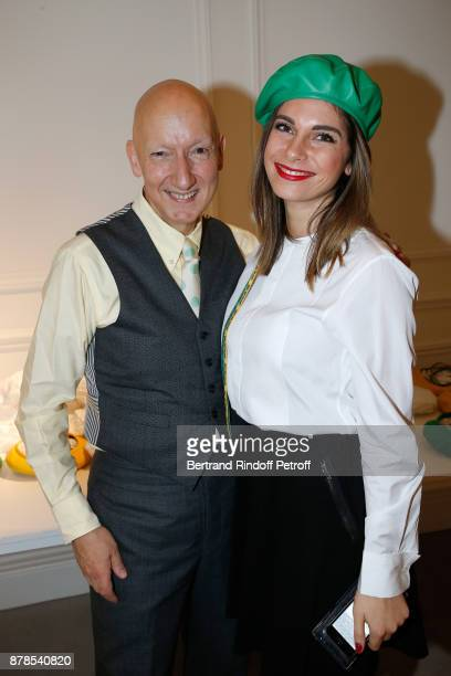 Stephen Jones hat designer for Christian Dior fashion house poses with a Catherinette during Dior celebrates SainteCatherine at Dior Boutique on...