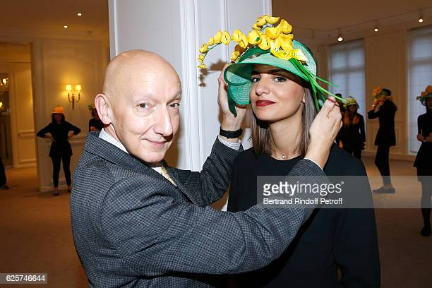 Stephen Jones hat designer for Christian Dior fashion house poses with Catherinettes and Nicolas from Dior during the SainteCatherine Celebration at...
