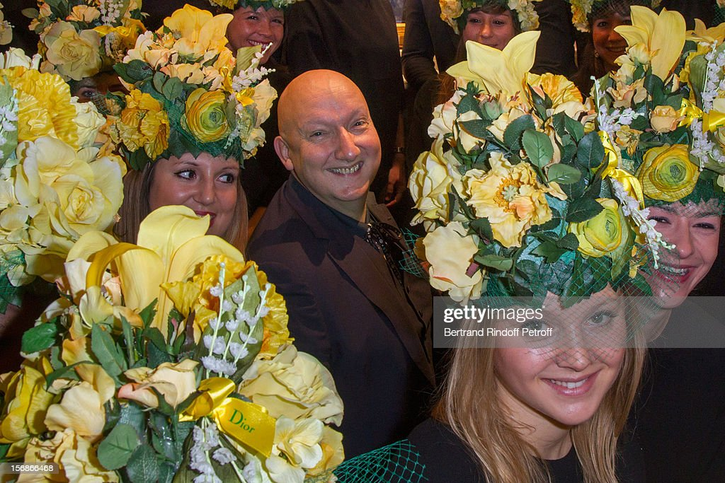 Stephen Jones, hat designer of Christian Dior fashion house, poses with young Dior employees at the Dior Boutique during the Sainte-Catherine Celebration on November 23, 2012 in Paris, France.