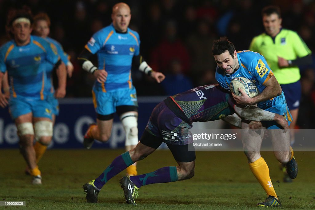 Stephen Jones (R) of London Waspsis held up during the Amlin Challenge Cup Pool Three match between Newport Gwent Dragons and London Wasps at Rodney Parade on January 17, 2013 in Newport, Wales.