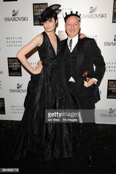 Stephen Jones wins the award for Outstanding Achievement In Fashion Design presented by Erin O'Connor at the 2008 British Fashion Awards at the Royal...