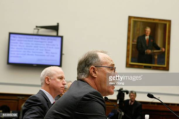 Stephen Joynt president and CEO of Fitch Ratings and Raymond McDaniel chairman and CEO of Moody's Corporatio testify during a hearing before the...