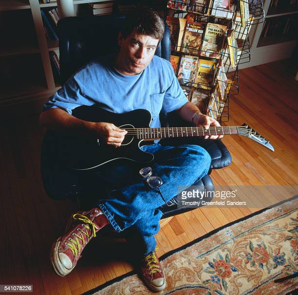 Stephen King Holding Guitar