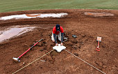 Stephen King Washington Nationals assistant field manager measures while setting second base as they prepare they field for opening day on March 17...