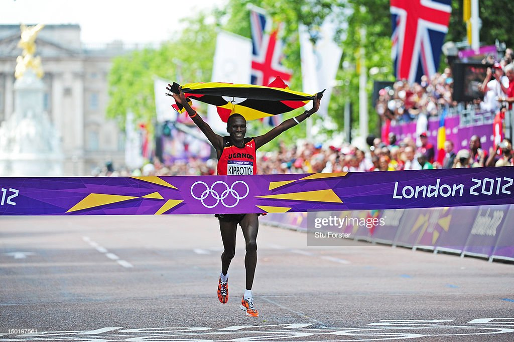 <a gi-track='captionPersonalityLinkClicked' href=/galleries/search?phrase=Stephen+Kiprotich&family=editorial&specificpeople=7069481 ng-click='$event.stopPropagation()'>Stephen Kiprotich</a> of Uganda celebrates as he approaches the line to win gold in the Men's Marathon on Day 16 of the London 2012 Olympic Games at The Mall on August 12, 2012 in London, England.