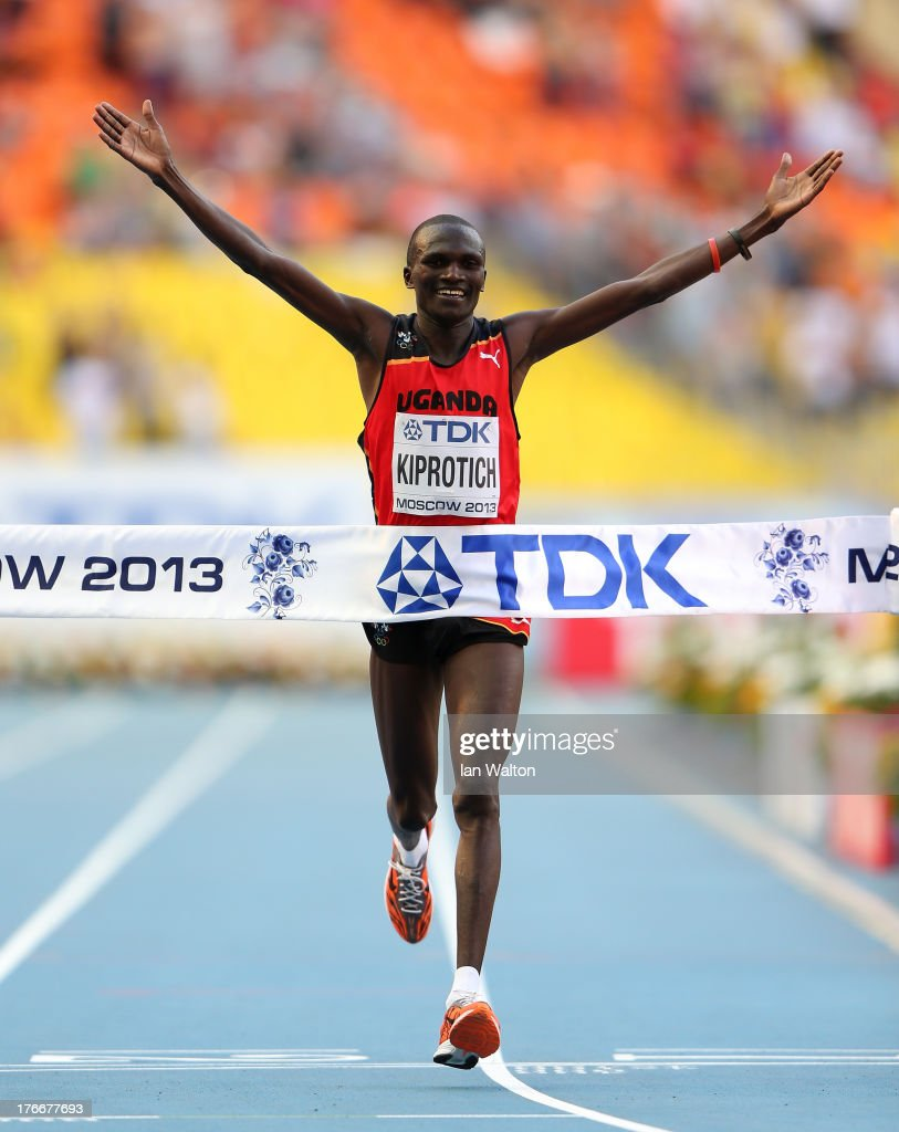 <a gi-track='captionPersonalityLinkClicked' href=/galleries/search?phrase=Stephen+Kiprotich&family=editorial&specificpeople=7069481 ng-click='$event.stopPropagation()'>Stephen Kiprotich</a> of Uganda crosses the line to win gold in the Men's Marathon during Day Eight of the 14th IAAF World Athletics Championships Moscow 2013 at Luzhniki Stadium on August 17, 2013 in Moscow, Russia.
