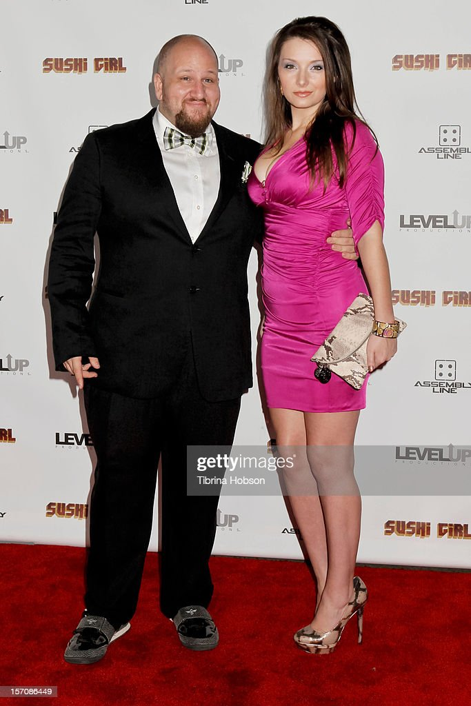 Stephen Kramer Glickman (L) and Guest attend the 'Sushi Girl' Los Angeles premiere at Grauman's Chinese Theatre on November 27, 2012 in Hollywood, California.