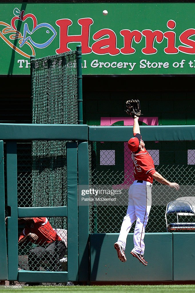 Stephen Lombardozzi #1 of the Washington Nationals is unable to catch a solo home run hit by <a gi-track='captionPersonalityLinkClicked' href=/galleries/search?phrase=DJ+LeMahieu&family=editorial&specificpeople=5940806 ng-click='$event.stopPropagation()'>DJ LeMahieu</a> #9 of the Colorado Rockies in the first inning during a game against the Washington Nationals at Nationals Park on June 22, 2013 in Washington, DC.