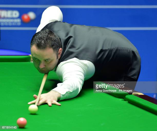 Stephen Maguire at the table in his match against Rory McLeod on day nine of the Betfred Snooker World Championships at the Crucible Theatre Sheffield