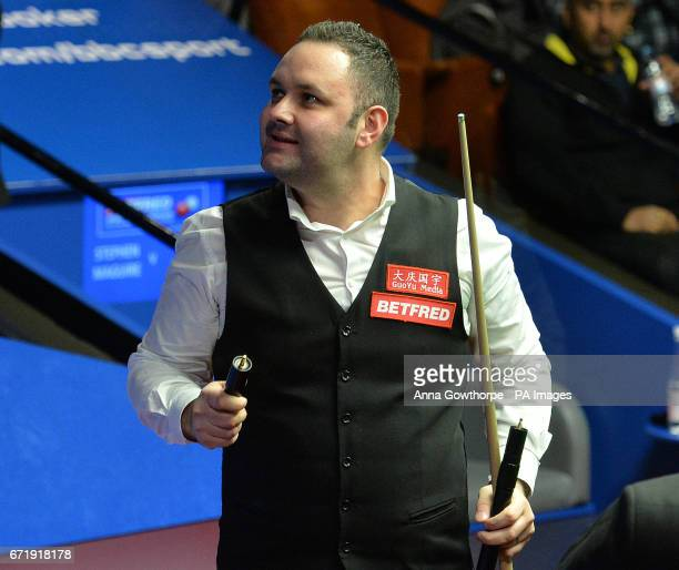 Stephen Maguire celebrates winning his match against Rory McLeod on day nine of the Betfred Snooker World Championships at the Crucible Theatre...
