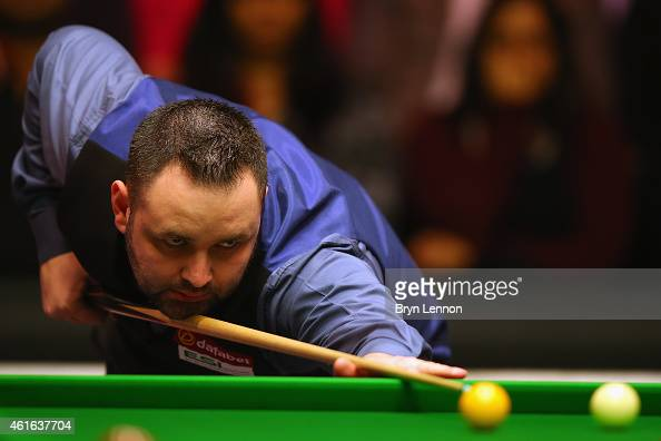 Stephen Maguire of Great Britain in action during his quarterfinal match against Shaun Murphy on day six of the Dafabet Masters at Alexandra Palace...