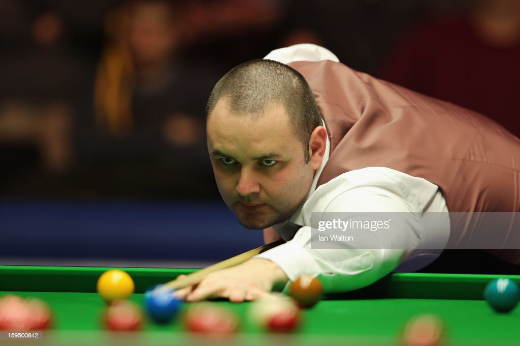 <a gi-track='captionPersonalityLinkClicked' href=/galleries/search?phrase=Stephen+Maguire&family=editorial&specificpeople=676261 ng-click='$event.stopPropagation()'>Stephen Maguire</a> of Scotland in action during his first round match against Graeme Dott of Scotland at Alexandra Palace on January 14, 2013 in London, England.