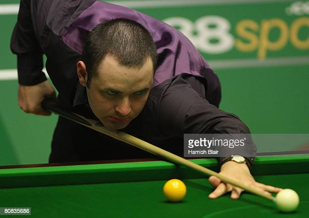 Stephen Maguire of Scotland in action during his match against Anthony Hamilton of England during day five of the 888com World Snooker Championships...