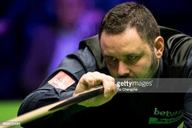 Stephen Maguire of Scotland plays a shot during his quarterfinal match against Joe Perry of England on day 12 of 2017 Betway UK Championship at...