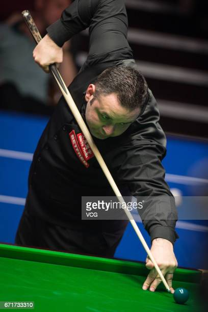 Stephen Maguire of Scotland plays a shot during his second round match against Rory McLeod of England on day eight of Betfred World Championship 2017...