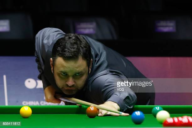 Stephen Maguire of Scotland plays a shot during his third round match against Shaun Murphy of England on day four of Evergrande 2017 World Snooker...